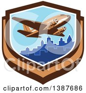 Clipart Of A Retro Vintage Passenger DC10 Airplane Flying Over A City In A Shield Royalty Free Vector Illustration