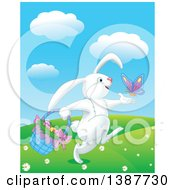 Happy White Bunny Rabbit Playing With A Butterfly And Carrying A Basket Of Easter Eggs