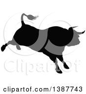Clipart Of A Silhouetted Black Bull Bucking Royalty Free Vector Illustration