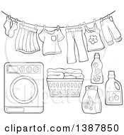 Clipart Of A Black And White Lineart Clothes Line With Laundry Air Drying Washing Machine Basket And Detergent Royalty Free Vector Illustration