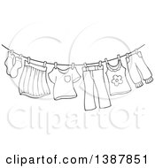 Clipart Of A Black And White Lineart Clothes Line With Laundry Air Drying Royalty Free Vector Illustration