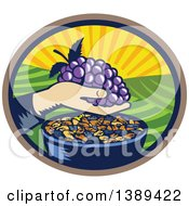 Clipart Of A Retro Woodcut Hand Holding A Bunch Of Purple Grapes Over A Bowl Of Raisins In An Oval With A Sunrise Or Sunset Royalty Free Vector Illustration