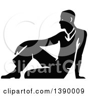 Clipart Of A Vintage Black And White Man Sitting On The Floor Royalty Free Vector Illustration