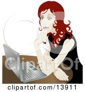 Poster, Art Print Of Pretty Redhead Businesswoman Sitting In Front Of A Laptop Computer
