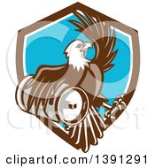 Clipart Of A Retro Bald Eagle Holding A Beer Keg And Emerging From A Shield Royalty Free Vector Illustration