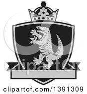 Clipart Of A Retro Grayscale Alligator Or Crocodile Coat Of Arms Shield With A Crown And Blank Banner Royalty Free Vector Illustration by patrimonio