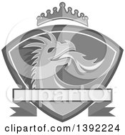 Clipart Of A Grayscale Fire Breathing Dragon Head In A Shield With A Crown And Banner Royalty Free Vector Illustration