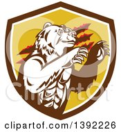 Clipart Of A Retro California Grizzly Bear Attacking In A Brown White And Yellow Shield Royalty Free Vector Illustration by patrimonio