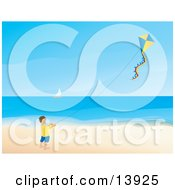 Happy Little Boy Flying A Kite On A Beach