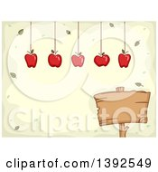 Apples Hanging Over A Blank Wood Sign With Text Space