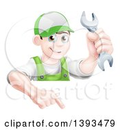 Clipart Of A Happy Young Brunette Caucasian Mechanic Man In Green Wearing A Baseball Cap Holding A Wrench Over A Sign Royalty Free Vector Illustration
