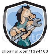 Clipart Of A Cartoon Horse Man Mechanic With Folded Arms Holding A Spanner Wrench In A Black White And Blue Shield Royalty Free Vector Illustration