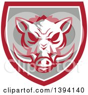 Clipart Of A Retro Wild Boar Head In A Gray Red And White Shield Royalty Free Vector Illustration by patrimonio
