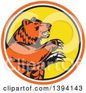Clipart Of A Retro California Grizzly Bear Attacking In An Orange White Black And Yellow Circle Royalty Free Vector Illustration by patrimonio