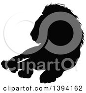 Clipart Of A Black Silhouetted Male Lion Resting Royalty Free Vector Illustration