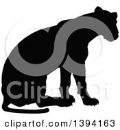 Clipart Of A Black Silhouetted Lioness Sitting Royalty Free Vector Illustration