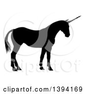 Clipart Of A Black Silhouetted Mythical Unicorn Standing Royalty Free Vector Illustration by AtStockIllustration