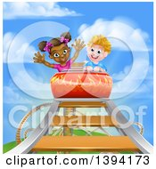 Happy White Boy And Black Girl At The Top Of A Roller Coaster Ride Against A Blue Sky With Clouds