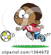 Clipart Of A Cartoon Black Boy Playing Soccer Royalty Free Vector Illustration by Ron Leishman
