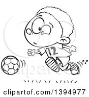 Clipart Of A Cartoon Black And White African American Boy Playing Soccer Royalty Free Vector Illustration by toonaday