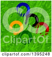 Clipart Of Colorful Olympics Rings In Grass Royalty Free Vector Illustration by elaineitalia