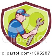 Clipart Of A Retro Cartoon White Handy Man Holding A Spanner Wrench In A Shield Royalty Free Vector Illustration