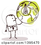 Clipart Of A Sketched Stick Business Man Holding A Globe With A Tower Royalty Free Vector Illustration