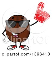 Clipart Of A Cartoon Coffee Bean Mascot Character Wearing Sunglasses And A Foam Finger Royalty Free Vector Illustration