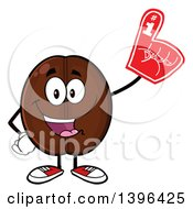 Clipart Of A Cartoon Coffee Bean Mascot Character Wearing A Foam Finger Royalty Free Vector Illustration by Hit Toon
