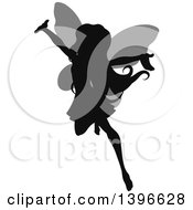 Clipart Of A Black Silhouetted Cheering Flying Female Fairy With Gray Wings Royalty Free Vector Illustration