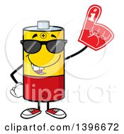 Clipart Of A Cartoon Battery Character Mascot Wearing Sunglasses And A Foam Finger Royalty Free Vector Illustration