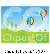 Two Colorful Hot Air Balloons Flying Over A Path Through A Hilly Landscape Clipart Illustration