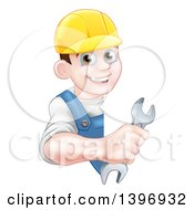 Clipart Of A Happy Young Brunette Caucasian Mechanic Man In Blue Wearing A Baseball Cap Holding An Adjustable Wrench Around A Sign Royalty Free Vector Illustration