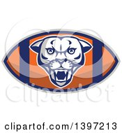 Clipart Of A Retro Fierce Mountain Lion Puma Cougar Face On An American Football Royalty Free Vector Illustration by patrimonio