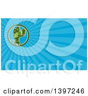 Clipart Of A Retro Film Movie Camera And Blue Rays Background Or Business Card Design Royalty Free Illustration