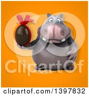 Clipart Of A 3d Henry Hippo Character Holding A Chocolate Egg Royalty Free Illustration