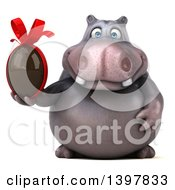Clipart Of A 3d Henry Hippo Character Holding A Chocolate Egg On A White Background Royalty Free Illustration by Julos