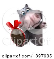 Clipart Of A 3d Henry Hippo Character Holding A Chocolate Egg On A White Background Royalty Free Illustration