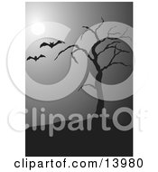 Two Vampire Bats Flying Past A Bare Tree In The Moonlight On A Foggy Night On Halloween Clipart Illustration