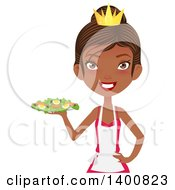 Happy Black Female Chef Wearing An Apron And Crown And Serving A Salad
