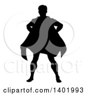 Black Silhouetted Male Super Hero Standing With Hands On His Hips