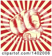 Clipart Of A Retro Woodcut Or Engraved Revolutionary Fist Over Beige And Red Rays Royalty Free Vector Illustration