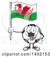 Clipart Of A Cartoon Soccer Ball Mascot Character Holding A Wales Flag Royalty Free Vector Illustration