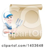 Clipart Of A Happy Young Brunette White Male Gardener In Blue Holding A Garden Fork Around A Scroll Sign Royalty Free Vector Illustration