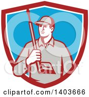 Clipart Of A Retro Male Pressure Washer Worker Holding A Washing Gun In A Red White And Blue Shield Royalty Free Vector Illustration