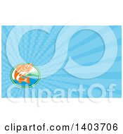 Clipart Of A Retro Orange And White Walleye Fish Jumping In Front Of A Lake Front Cabin And Blue Rays Background Or Business Card Design Royalty Free Illustration