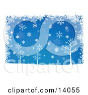 Winter Snowflakes Falling Over Bare Trees On A Blue Background