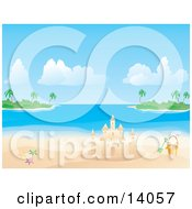 Colorful Starfish By A Sand Castle And Pail On A Tropical Beach With White Sands And Two Islands In The Distance