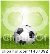 Clipart Of A 3d Soccer Ball On Grass Against Green Flares Royalty Free Vector Illustration