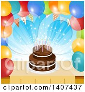Chocolate Birthday Cake In A Border Of Party Balloons And A Bunting
